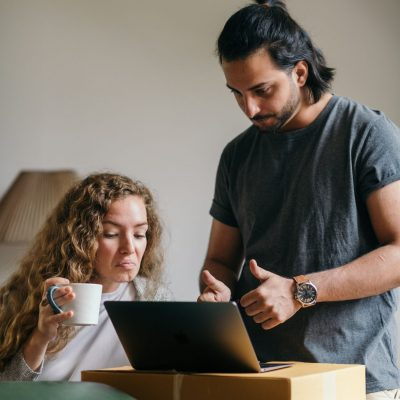 young-couple-buying-things-for-new-house-online-using-laptop-1960x2940